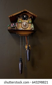 Germany cuckoo clock hanging on the wall.