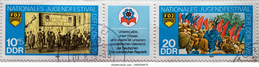 GERMANY, DDR - CIRCA 1979 : a postage stamp from Germany, GDR showing the National Youth Festival, Berlin: torchlight procession and rally