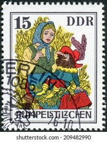 GERMANY (DDR) - CIRCA1976: Postage stamp printed in Germany, shows a scene from a fairy tale by the Brothers Grimm, Rumpelstiltskin, circa 1976