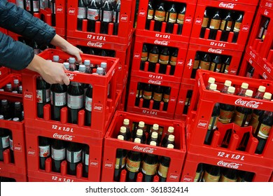 GERMANY - DECEMBER 21: Stack of crates Coca-Cola soft drinks bottles in a Kaufland Hypermarket. The Coca-Cola Company is an American multinational corporation. Taken on December 21, 2015 in Germany