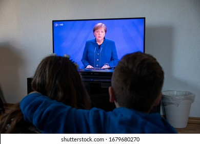 Germany Dortmund 22.3.2020  Kids and people watching on TV Angela Merkel Chancellor of Germany for the Curfew