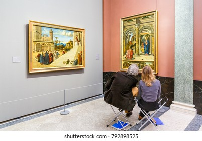 GERMANY, DRESDEN - 21 DECEMBER 2017: Visitors looking at painting of old masters in famous Dresden art gallery in Germany.