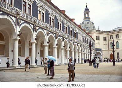 GERMANY, DRESDEN - 26 JUNE 2018: travelers walking on square near old historical zwinger palace