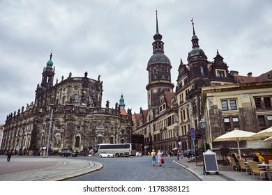 GERMANY, DRESDEN - 26 JUNE 2018: travelers walking near old Cathedral of Holy Trinity