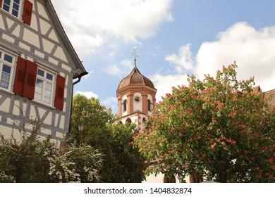 GERMANY, BADEN-WÜRTTEMBERG, ENZKREIS, NEUHAUSEN, MAY 19, 2019: Church tower of St. Urban und Vitus