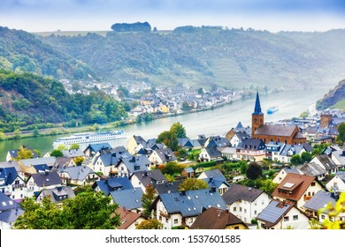 Germany, Europe. Traditional Panorama of Moselle river valley, view of towns Alken and Kattenes. Nearby Thurant Castle on hill top. Picturesque seasonal autumnal landscape of German countryside.