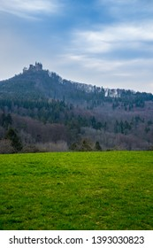Germany, Famous ancient hohenzollern castle on top of mountain in swabian jura nature landscape