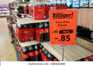 GERMANY - FEBRUARY 1, 2018: Discount sign for Coca Cola PET bottles in a German Lidl supermarket.