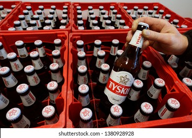 GERMANY - FEBRUARY 19, 2019: Tyskie beer crates in a grocery. Tyskie is a Polish lager beer. Its name comes from the brewery located in the Upper Silesia town of Tychy.