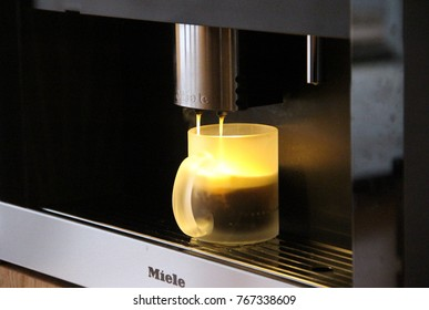 GERMANY - February, 2016: Using Miele Built-In Coffee Machines for hot Americano in Germany