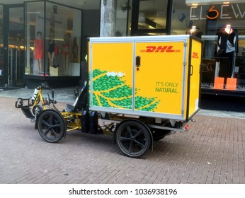Düsseldorf, Germany - February 28, 2018: DHL inner-city Electric Delivery Cargo Bike.
