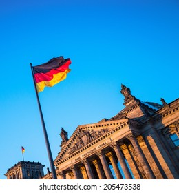 Germany flag in front of the Reichstag building.