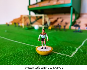 Germany football figure lined up on a grass field