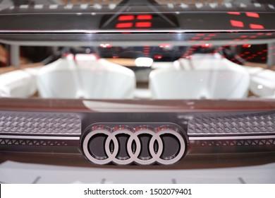 Germany, Frankfurt - 10.September 2019: Audi AI:ME - AIME e-tron,  Audi electric car concept study - detail view of the car body with audi logo -  IAA Car Show Frankfurt 2019