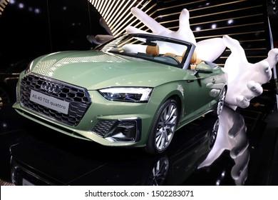Germany, Frankfurt - 10.September 2019:  green Audi A5 TDI  quattro, Tiptronic  - detail view of the car body - IAA Car Show Frankfurt 2019