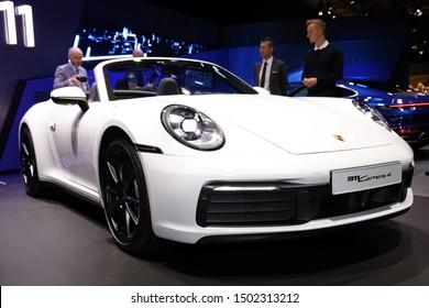 Germany, Frankfurt - 10.September 2019: Porsche 911 Carrera 4  Super Sports Car - detail front view of the car body - IAA Car Show Frankfurt 2019