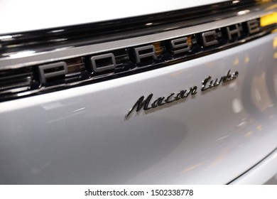 Germany, Frankfurt - 10.September 2019: Porsche Macan Turbo - detail view of the car body with Porsche Macan Turbo logo - Sports Car - IAA Car Show Frankfurt 2019