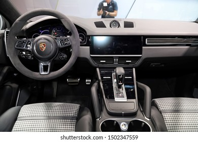 Germany, Frankfurt - 10.September 2019: Porsche Cayenne Turbo S - E-Hybrid Coupe - Interior detail view with controls and steering wheel, Sports Car - IAA Car Show Frankfurt 2019