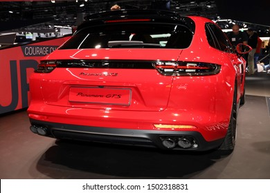 Germany, Frankfurt - 10.September 2019: red Porsche Panamera GTS Sport Touring - detail view of the car body - Sports Car - IAA Car Show Frankfurt 2019