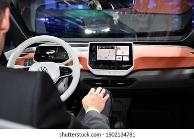 Germany, Frankfurt - 10.September 2019: Volkswagen VW ID.3, VW electric car  ,with businessman inside the car -  IAA Car Show Frankfurt 2019