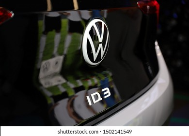 Germany, Frankfurt - 10.September 2019: Volkswagen VW ID.3, VW electric car  ,detail view of the car body with VW logo and ID.3 Text -  IAA Car Show Frankfurt 2019
