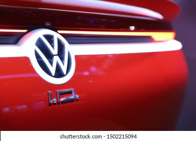 Germany, Frankfurt - 10.September 2019: Volkswagen VW I.D., VW ID electric car Concept ,detail view of the car body with VW logo and I.D. Text-  IAA Car Show Frankfurt 2019