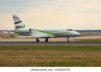 GERMANY, FRANKFURT - SEPTEMBER 05, 2015: Dassault Falcon 2000S, SP-ARK of Private owner taxis on the runway at Frankfurt Airport