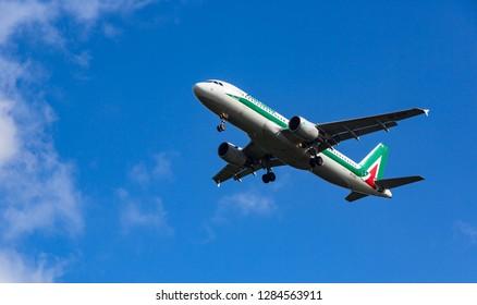 GERMANY, FRANKFURT - SEPTEMBER 06, 2015: Airbus A320-216, EI-DTE of Alitalia flies in the sky