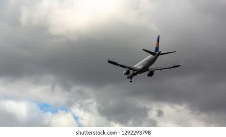 GERMANY, FRANKFURT - SEPTEMBER 06, 2015: Embraer ERJ-190LR, D-AECE of Lufthansa in thunder clouds