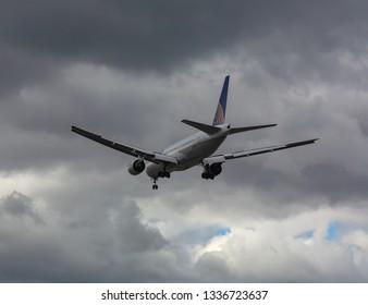 GERMANY, FRANKFURT - SEPTEMBER 06, 2015: Boeing 777-222, N221UA of United Airlines landing approach at Frankfurt Airport