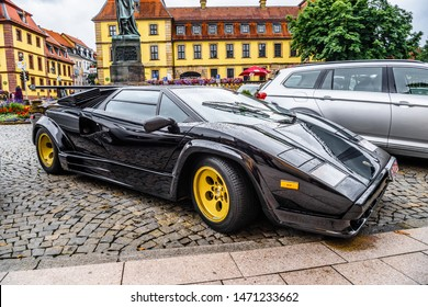 GERMANY, FULDA - JUL 2019: black LAMBORGHINI COUNTACH is a rear mid-engine, rear-wheel-drive sports car produced by the Italian automobile manufacturer Lamborghini from 1974 to 1990.