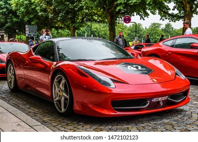 GERMANY, FULDA - JUL 2019: red FERRARI 458 SPIDER coupe was introduced at the 2011 Frankfurt Motor Show. This convertible variant of the 458 Italia features an aluminium retractable hardtop