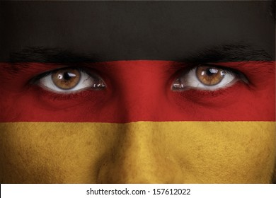 germany, german flag painted on the face of young man