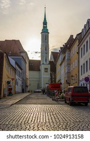 Germany, Goerlitz 27 December 2017:town square in a small provincial town, at sunrise reflection on paving stones