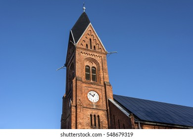 Germany, Greifswald, Wieck - December 30, 2016: Steeple of local neo-Romanesque church (Bugenhagenkirche) of the small fishing village.