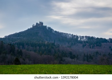 Germany, Hohenzollern castle on top of a mountain covered by forest in swabian jura countryside