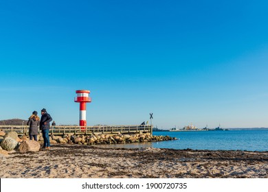 Eckernförde, Germany, January 16, 2021 - Eckernförde, even in winter a walk on the beach on the long city beach of the tourist metropolis is worthwhile, you can enjoy the deep winter sun