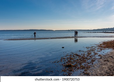 Eckernförde, Germany, January 16, 2021 - Eckernförde, even in winter, a walk on the beach on the long city beach of the tourist metropolis is worthwhile, you can enjoy the deep winter sun