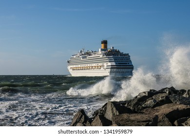 Warnemünde, Germany - July 05, 2018 - stormy weather - Cruise ship 'Costa Favolosa' leaves the harbor