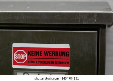 """LÜBECK, GERMANY - JULY 18 2019:   red sign on the mailbox saying """"stop- no ads"""""""