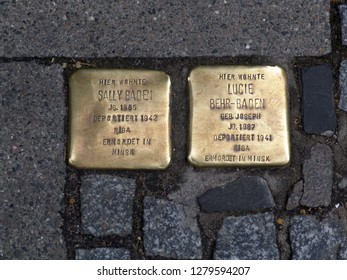 Lüneburg, Germany - July 19, 2005: so-called stumbling blocks in the pavement of a street in memory of the deportation and murder of Jewish fellow citizens at the time of the 3rd Reich