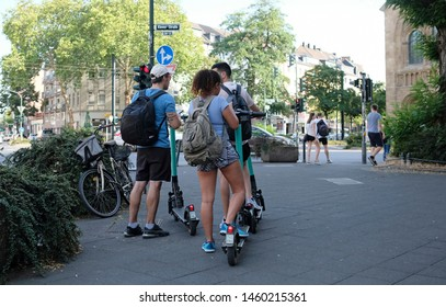 Düsseldorf, Germany - July 24, 2019: E-mobility in Germany: Inhabitants of Düsseldorf trying out electric scooters.