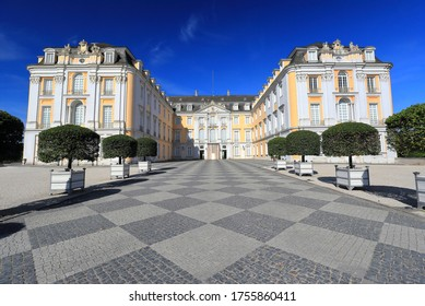Brühl, Germany – June 02, 2020: Visiting the Baroque Augustusburg Palace on a sunny morning in June.