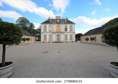 Brühl, Germany – June 12, 2020: Visiting the Baroque Falkenlust hunting lodge on an evening in June.