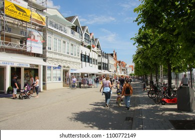 TRAVEMÜNDE, LÜBECK, GERMANY - JUNE 13, 2011:The hustle and bustle of the popular German coastal resort of  Travemünde, located at the mouth of the river Trave and on the coast of the Baltic Sea.
