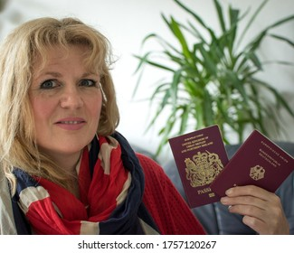 Osnabrück, Germany - June 14 2020: person with dual citizenship holding British and German passports