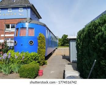 Travemünde - Germany - June 17, 2013: Saloon car and clubhouse of the Eisenbahner Hochsee-Sportfischer-Verein e.V. in Travemünde.
