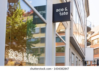 "Düsseldorf, Germany - June 2019: Exterior view in front of "" ACE & TATE "" storefront, European fashion brand with glasses, sunglasses and accessories, in old town Düsseldorf, Germany."