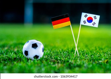 Germany - Korea Republic, South Korea, Group F, Wednesday, 27. June, Football, National Flags on green grass, white football ball on ground.