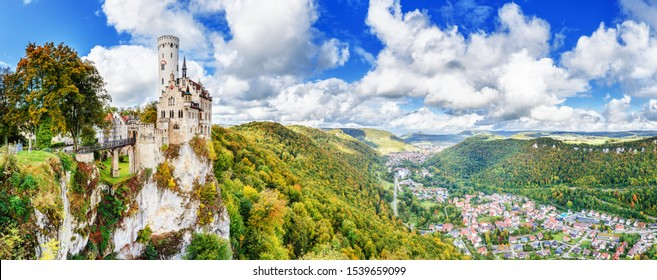 Germany, Lichtenstein Castle in Baden-Wurttemberg land in Swabian Alps. Seasonal panorama of  Lichtenstein Castle on a cliff circled by colorful trees, German countryside . European famous landmark.